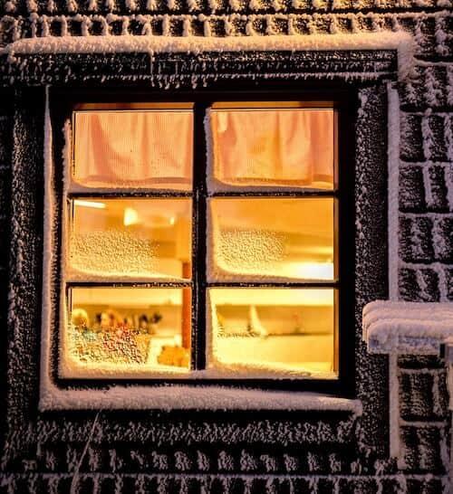 warm house with snowy window