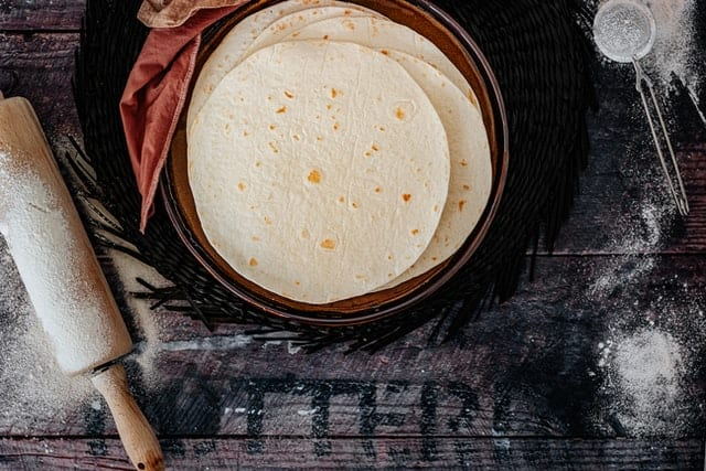 Can dogs eat tortillas corn flour nutrition sodium grains gluten allergies